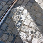 Cobblestone, tram rail, and crosswalk in Prague.