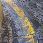 Prague street, cobblestone, yellow stripe.