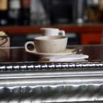 Coffee cup on the bar at Cafe de la Presse in San Francisco.