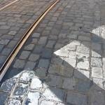 Cobblestone street, tram rails and crosswalk in Prague.