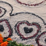 Hearts made from dried red and black beans decorating an altar at the Day of the Dead in Oakland.