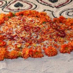 A heart made out of marigolds in one of the altars at the Day of the Dead festival in Oakland