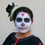 Skull face paint and costume for Day of the Dead in Oakland.