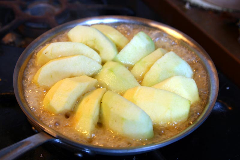 Apples cooking for a Tarte Tatin.