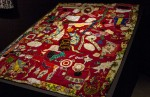 Unfinished (red velvet and embroidery) quilt pieced together by Rosie Lee Tompkins