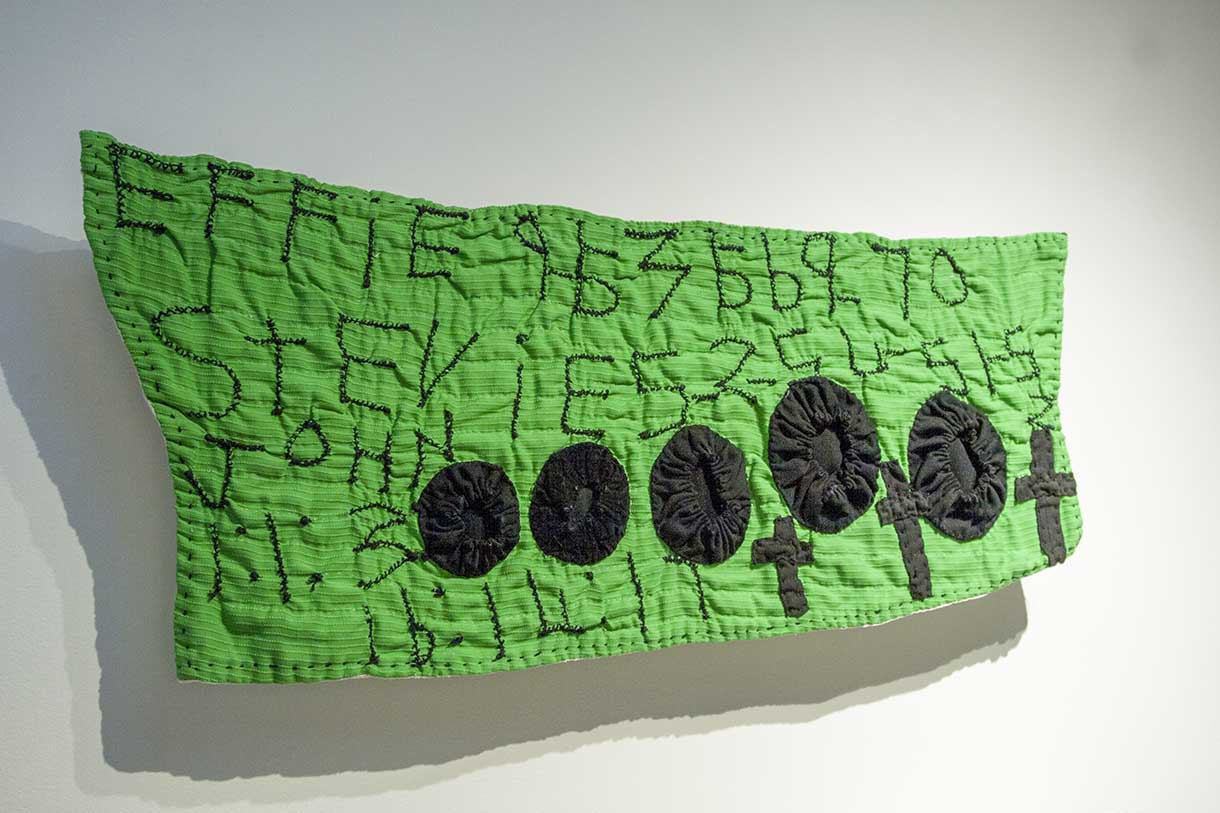 """""""Black Yo-Yos on Green Hanging (Stevie)"""", quilted by Irene Bankhead and pieced together by Rosie Lee Tompkins"""