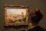 Woman contemplating a Turner.