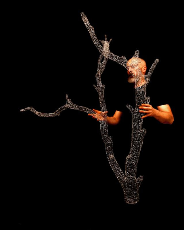 Kirk Maxson with tree branch sculpture