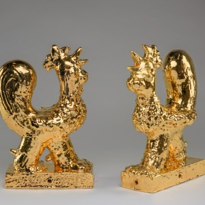 """Golden Rooster 1"", 2018, glazed ceramic and gold luster, 16 1⁄2"" x 10 1⁄2"" x 7"" ""Golden Rooster 2"", 2018, glazed ceramic and gold luster, 16 1⁄2"" x 10 1⁄2"" x 7"""