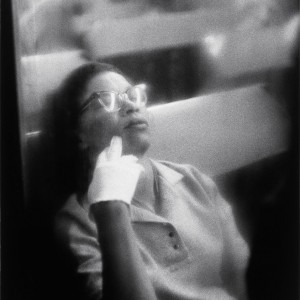 Louis Stettner, Woman with White Glove, Penn Station, 1958, Gelatin silver print, 13 3/4 x 9 inches