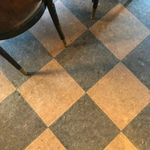 Old tiled floor in the upstairs of Vesuvio, in San Francisco.