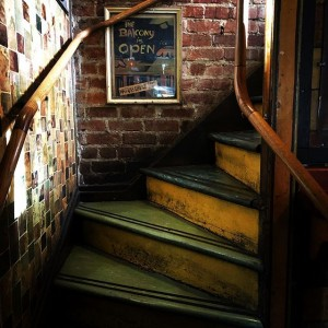 Stairs to the balcony in Vesuvio in San Francisco.