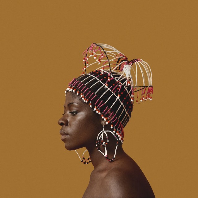 Kwame Brathwaite, Sikolo Brathwaite wearing a headpiece designed by Carolee Prince, African Jazz-Art Society & Studios (AJASS), Harlem, ca. 1968; from Kwame Brathwaite: Black Is Beautiful (Aperture, 2019) Courtesy the artist and Philip Martin Gallery, Los Angeles