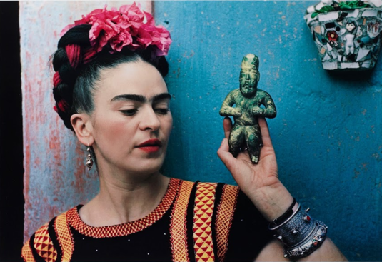 "Nickolas Muray, ""Frida with Olmeca Figurine, Coyoacán"", 1939."