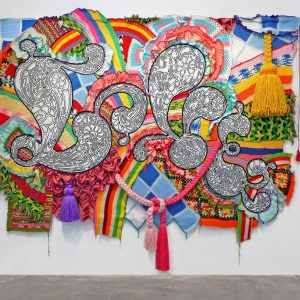 Miyoshi Barosh, LOVE, 2007, recycled afghans, acrylic yarn, pom-poms, canvas, grommets, 96 x 114 x 10 in.