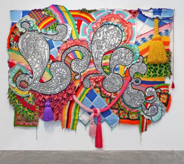 Miyoshi Barosh, LOVE, 2007, recycled afghans, acrylic yarn, pom-poms, canvas, grommets, 96 x 114 x 10 in.