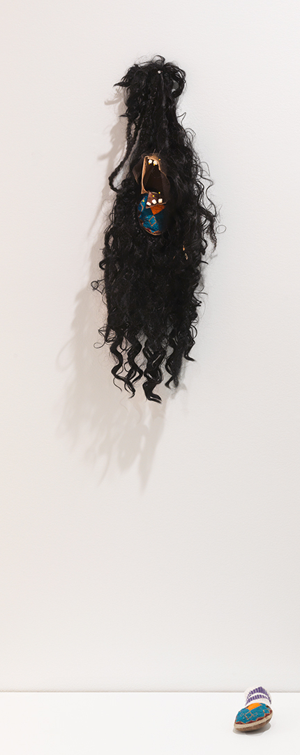 "Natalie Ball, When Harry met Sally. I mean, when my Mom met my Dad. I mean, when my Ancestors met my Ancestors. I mean, when a Lace Front met a Smoked Skin., 2019, beads, elk hide, wig, cotton, metal, and Skookum dolls, 35 ½"" x 10 ½"" x ¾"""