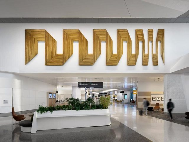 Andy Vogt Unfolding Space (in gold), at SFO :: photo by Matthew Millman
